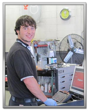 Daniel Szittai - Mechanic, working on at an electronic diagnostic software station